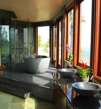 Tropical bathrom with concrete tub
