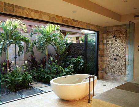Tropical bathroom with white tub
