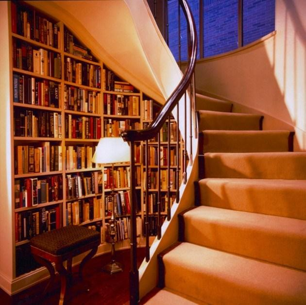 Twisted home staircase and a small library beneath it