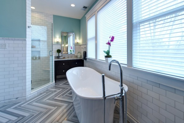 Wainscoting painted in white- Modern Art Deco Bathroom Design in a Victorian Home