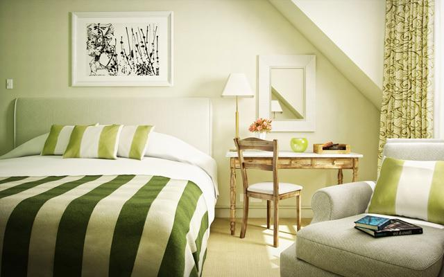White and green bedroom with striped cover