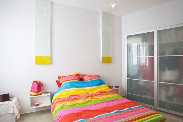 White bedroom with colorful bed cover
