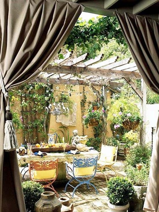 Wooden pergola and a table below it- Ideas for home outdoor spaces