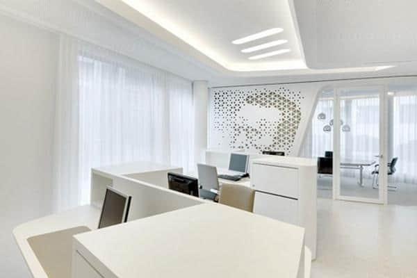 Working_desks_with_computer_stations_and_white_cabinets-Modern Bank Interior Design - Raiffeisen in Zurich