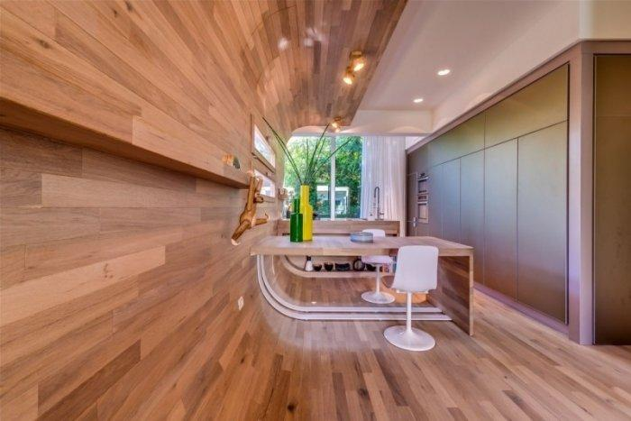 Amazing room with rounded walls with wooden panels
