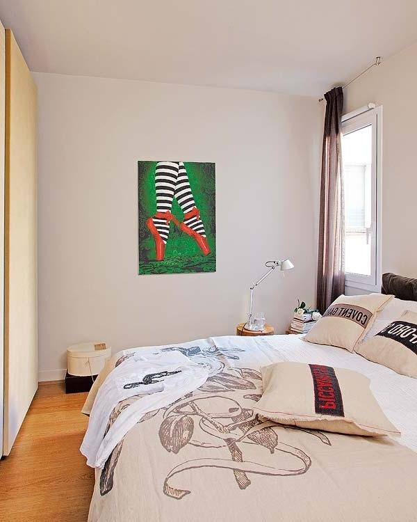 Artistic bedroom with modern wall painting and white walls