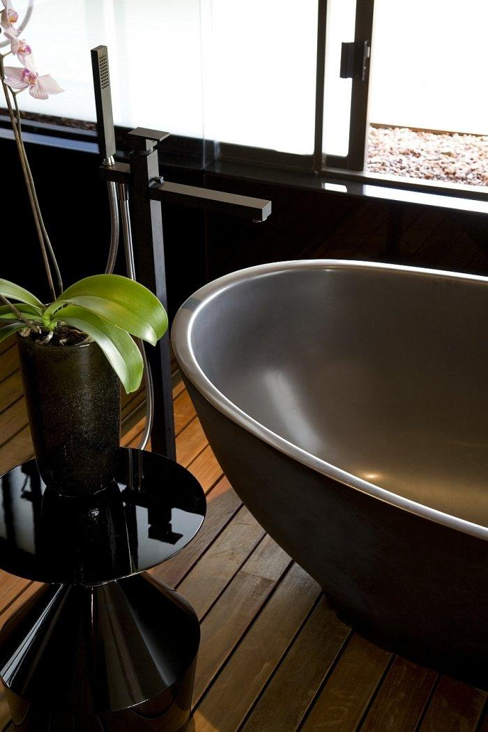 Bathroom sink -details from the luxurious dark interior