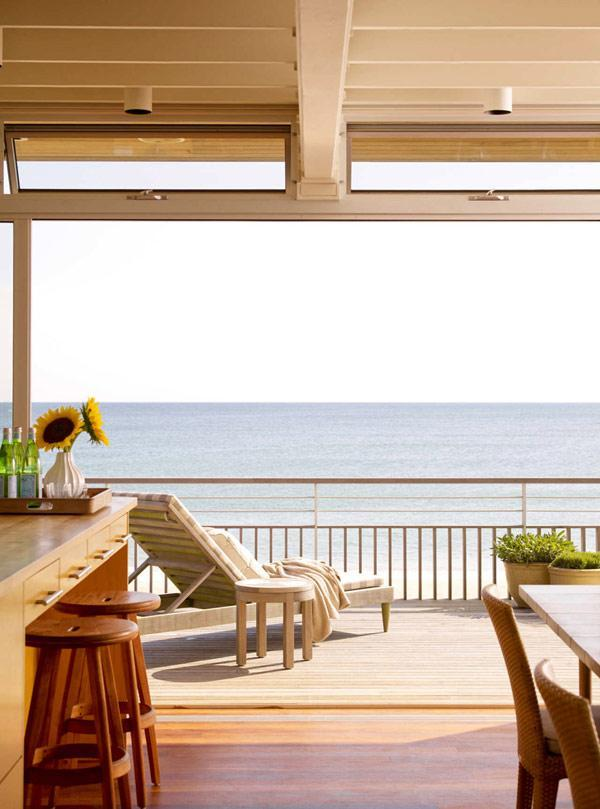 Beach house and its terrace overviewing the boundless sea