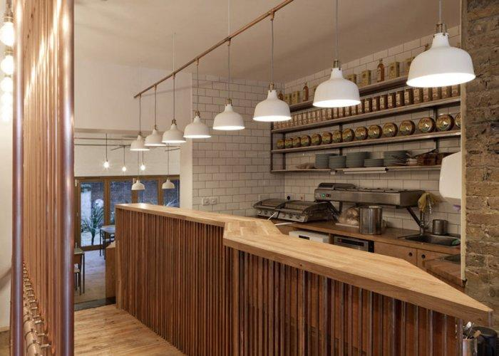 Cafe interior design with spacious bar panel and white pendants
