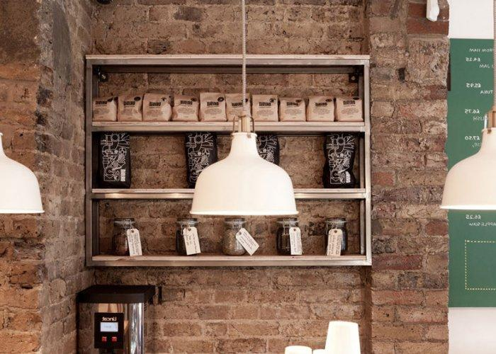 Cafe shelves placed at an exposed brick wall with authentic look