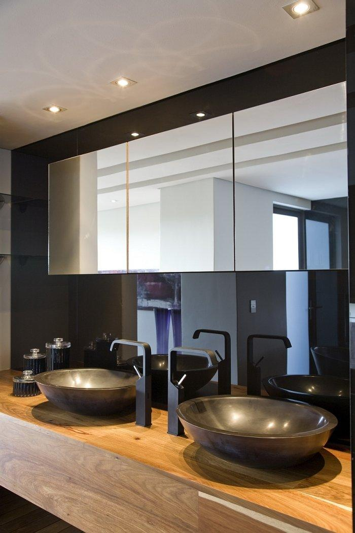 Contemporary bathroom vanity with two sinks and wooden surface