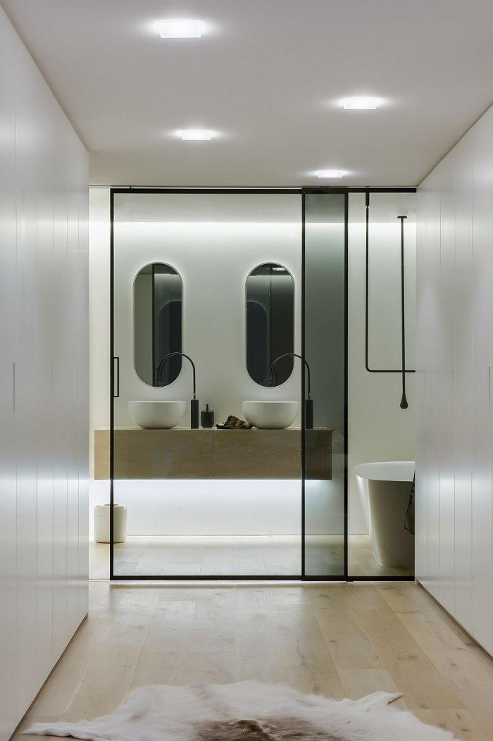 Contemporary bathroom with semi-transparent sliding door in black