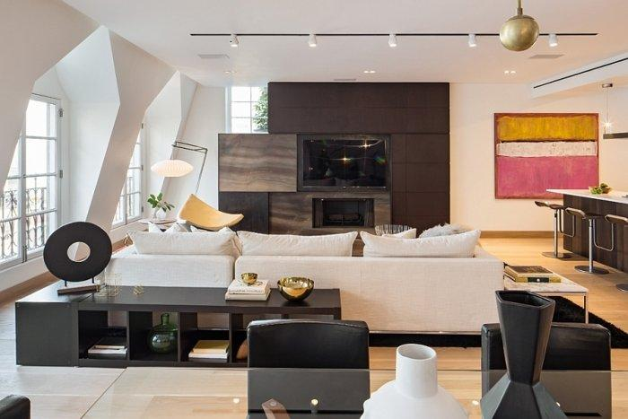 Contemporary living room in white inside a New York penthouse