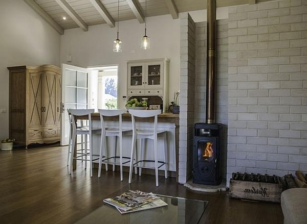 Contemporary living room with vintage stove and soft furniture