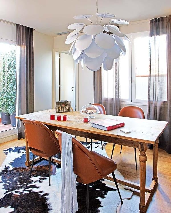 Dining room with rustic table and modern pendant