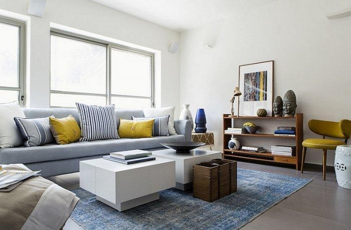 Eclectic living room with minimalist coffee tables and traditional sofas