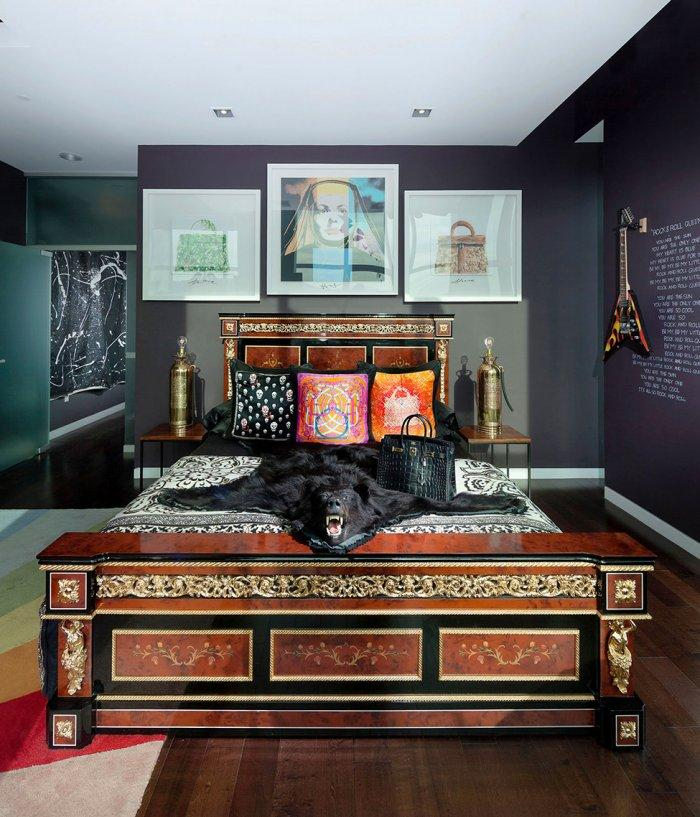 Eclectic master bedroom with solid wood bed and abstract decorations