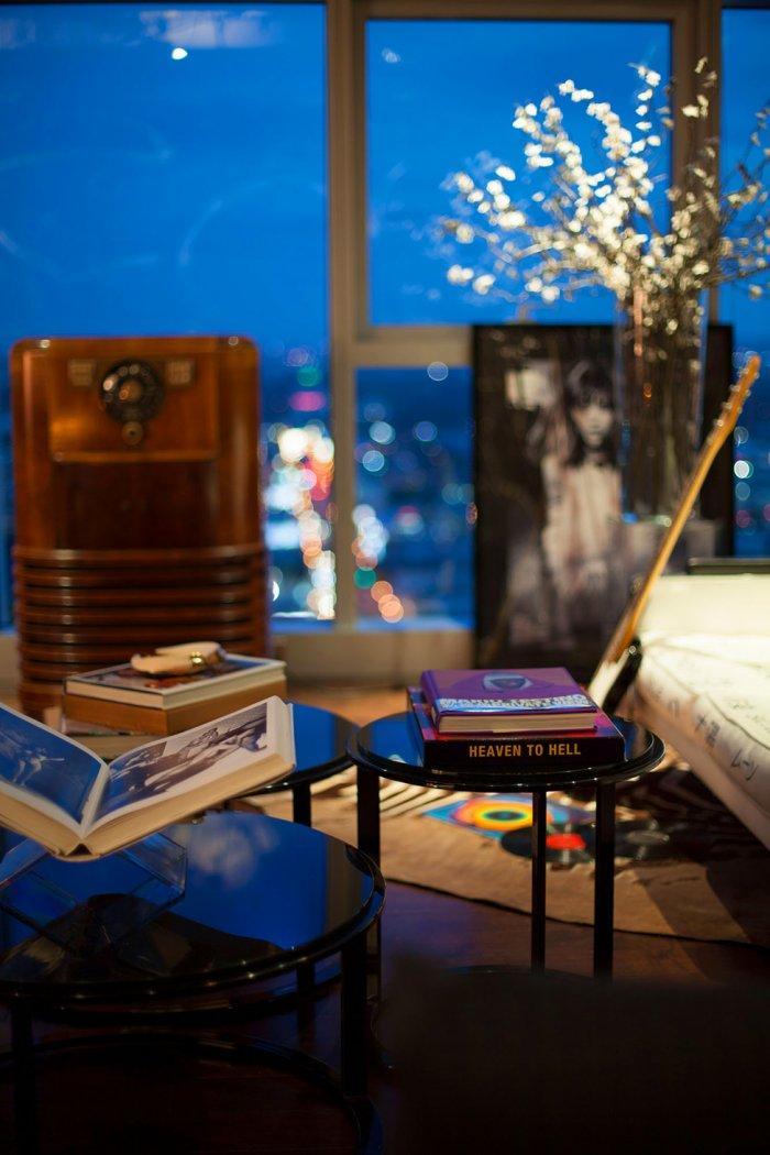Eclectic room decorated with books placed on small tables