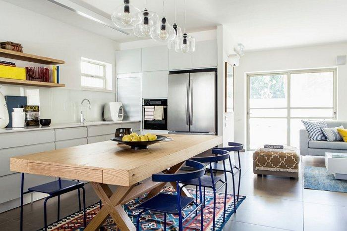Eclectic room with minimalist cooking area and interesting decorations