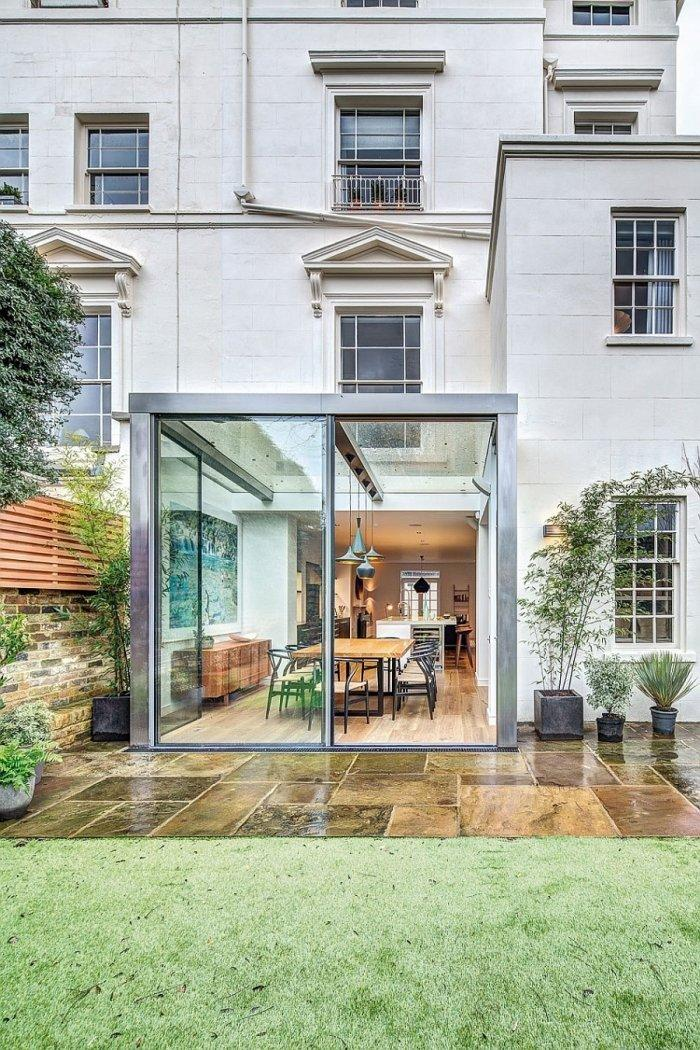 English home facade with glazed cubic room for dinner