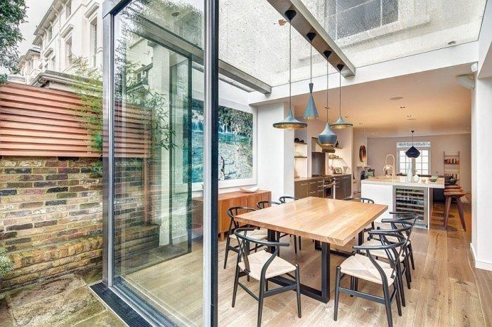 English home with glass sliding door leading outside