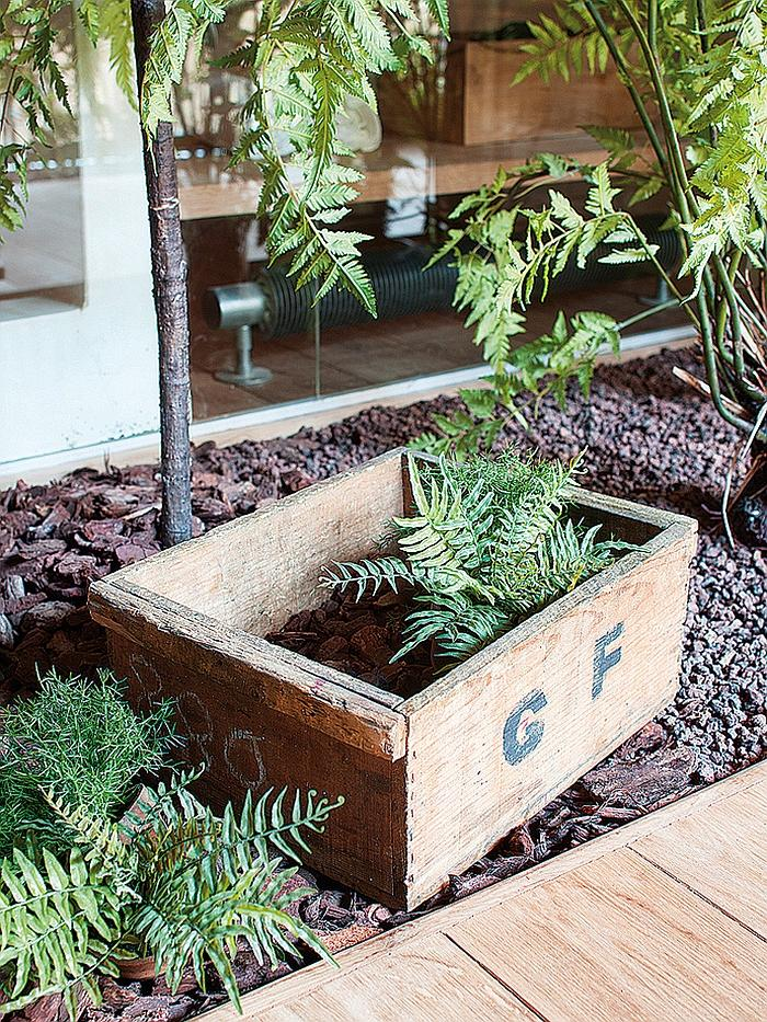 Flower pot made of wooden material and placed in the garden