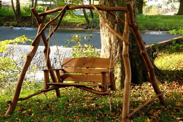 Garden Swing With Rustic Look Near A Pond
