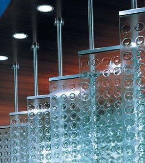 Glass fence made of several panels that hang from the ceiling