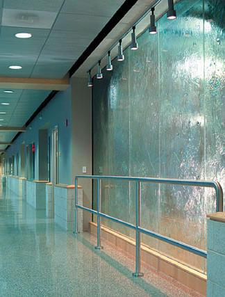 Glass wall with flowing water from the ceiling to the floor