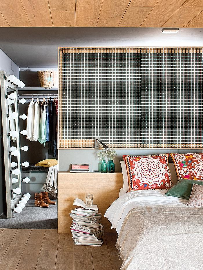 Industrial bedroom with colorful decorations and graphic elements