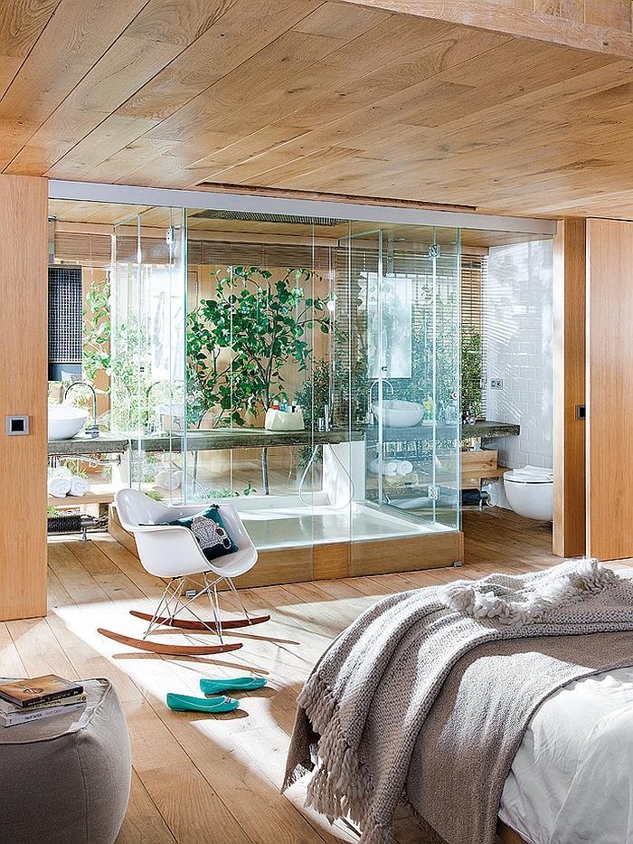 Industrial bedroom with inner garden separated by glass doors