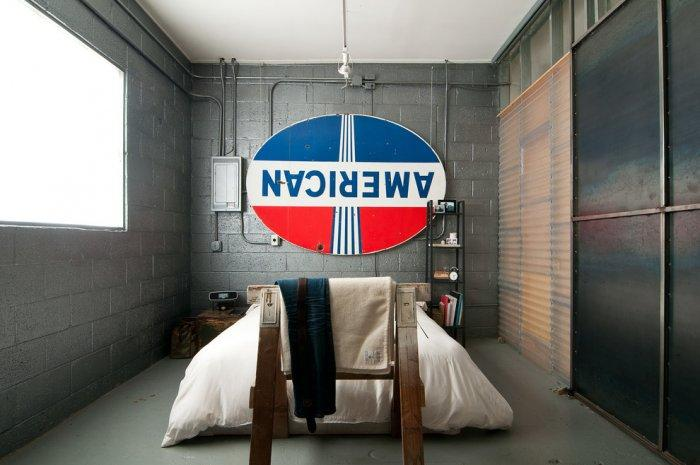 Industrial bedroom with simple interior and only one bed