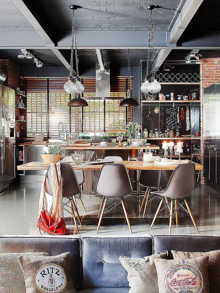 Industrial dining room with raw ceiling and modern furniture