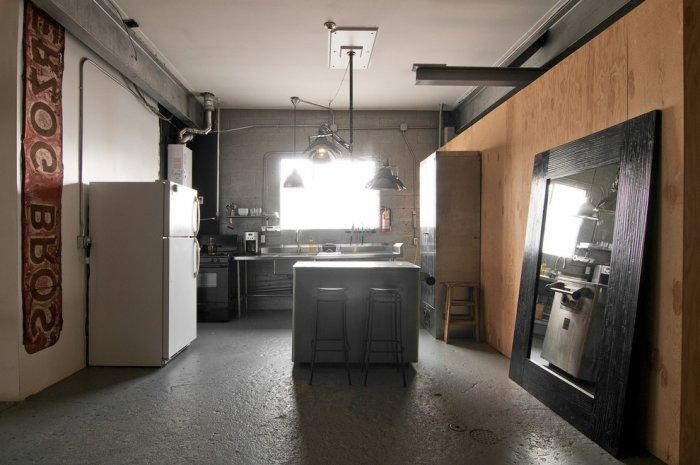 Industrial kitchen with raw interior desing lines in grey