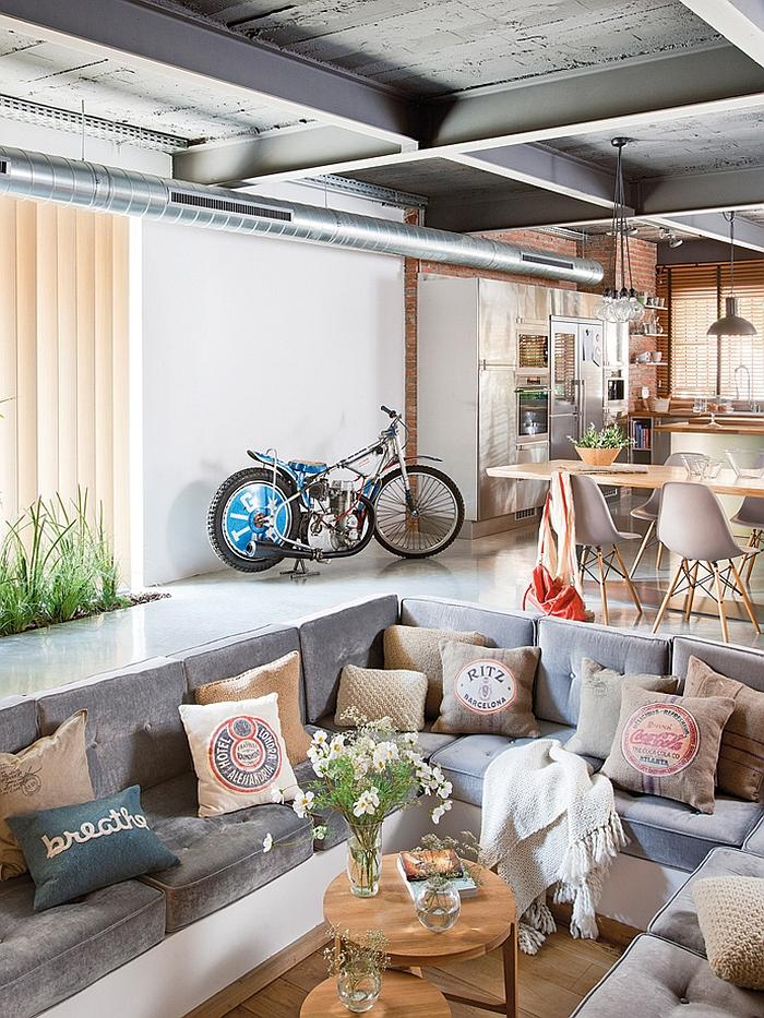 Industrial loft living room with exposed brick walls