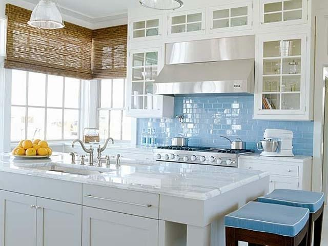 Kitchen design in a traditional home with sea blue and white colors