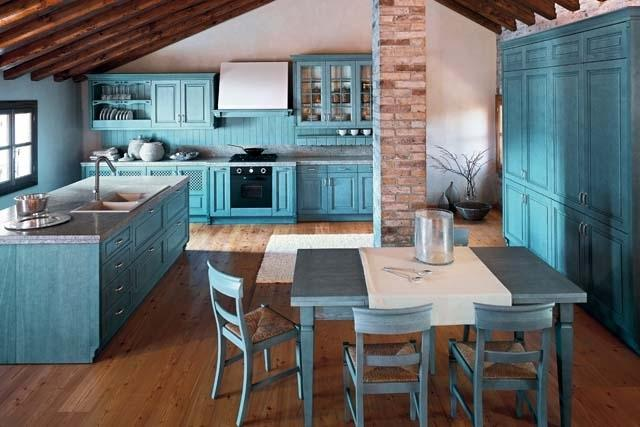 Kitchen design in cyan color and rustic barn beams on the ceiling