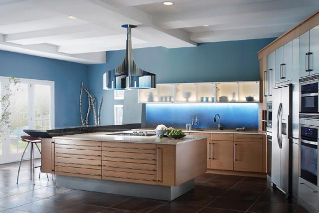 Kitchen design in luxurious home with island made of wood and bluish walls