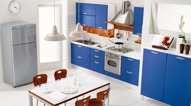 Kitchen design in modern style with blue cabinets and small table
