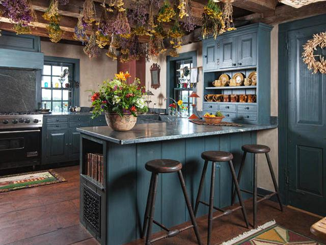 Kitchen design in rustic style with dark green walls and island