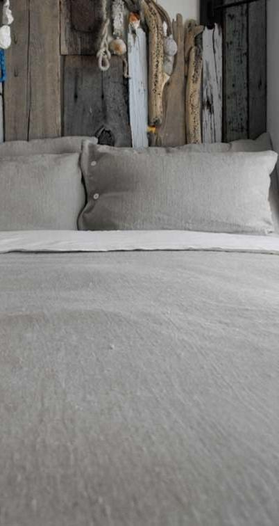 Linen bed sheets and pillow covers in grey