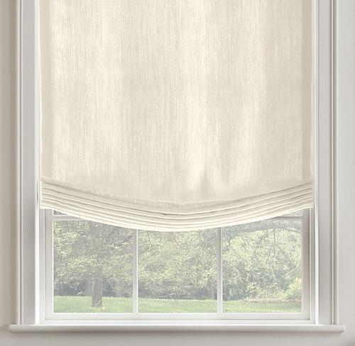 Linen curtains in white decorate the window