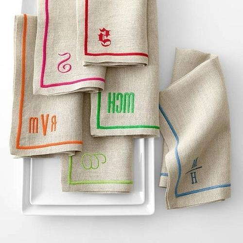 Linen napkins with colorful decorations and various letters