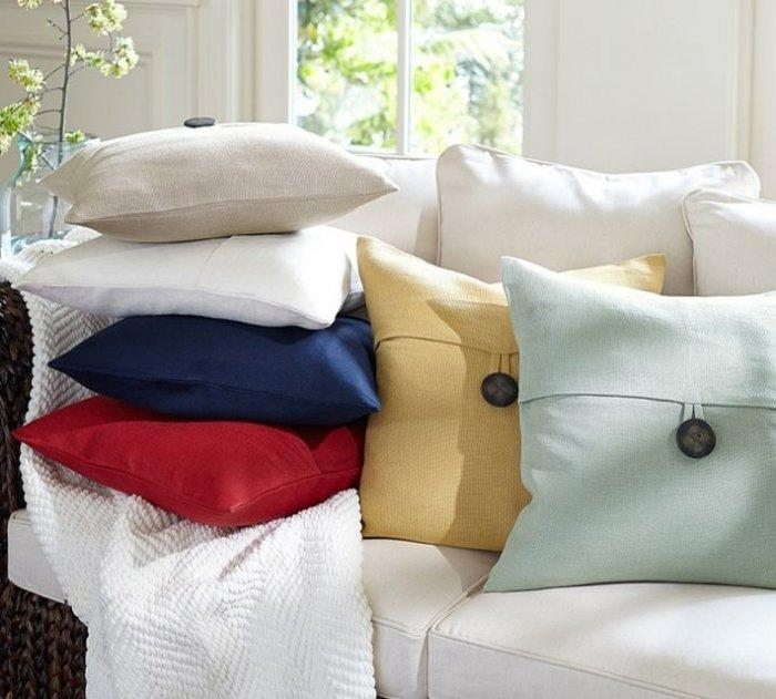 Linen pillow covers in various colors that decorate a sofa