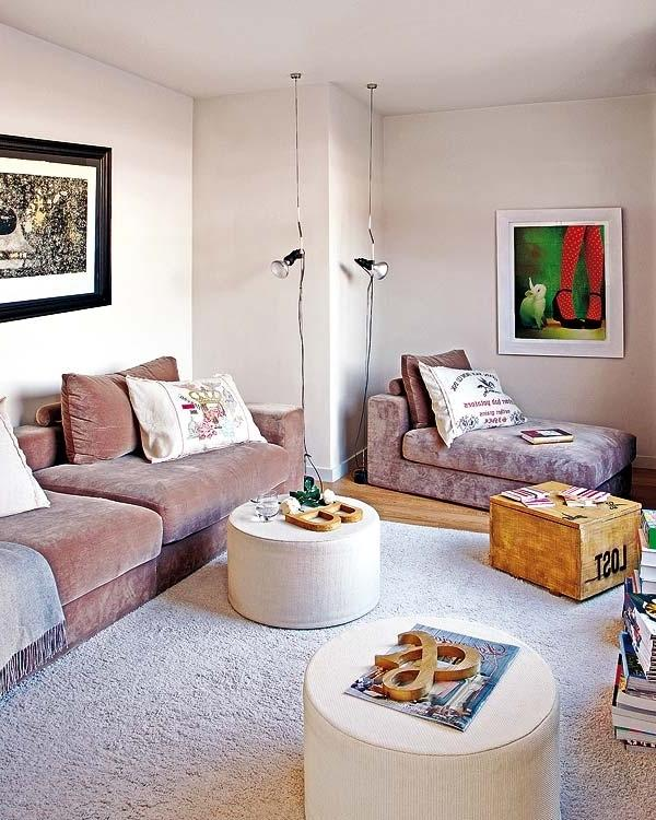 Living room in white with modern wall paintings