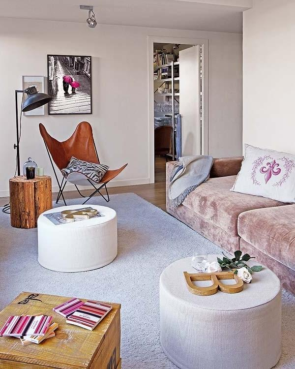 Living room with wall paintings and mid-century modern chair