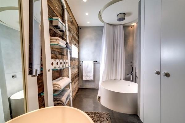 Luxurious bathroom with modern interior and rustic elements
