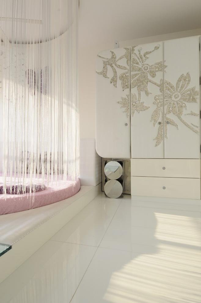 Luxurious bedroom with decorative flowers on the wardrobe in white