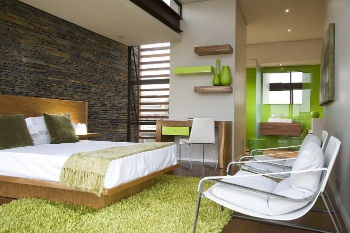 Luxurious bedroom with fresh green accents and modern furniture