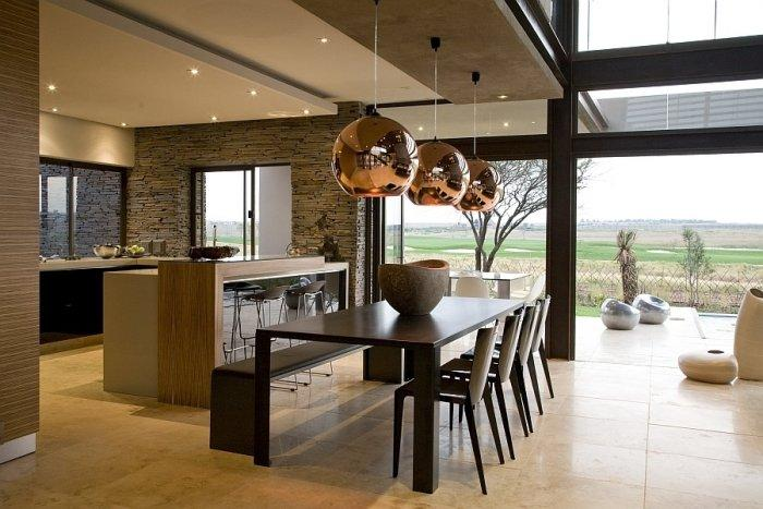 Luxurious dining area with modern chairs, table and pendants